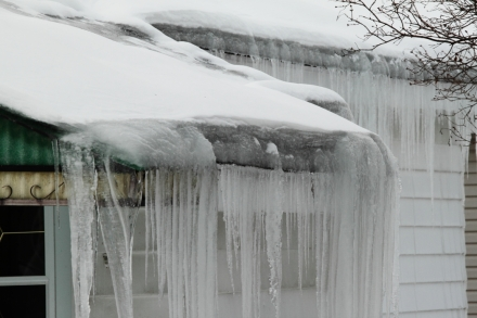 Ice dam on a poorly-insulated and ventilated bungalow roof.